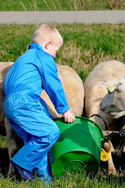 Regenpijp overall Blauw met tractor